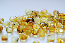 10 Grams Baltic amber rounded beads with holes. Polished lemon yellow beads
