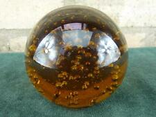 amber or brown Glass paperweight with bubbles