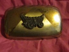 vintage covered wagon belt buckle