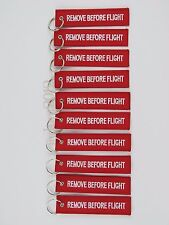 QTY=10 PIECE RED/WHITE REMOVE BEFORE FLIGHT KEY CHAIN TAGS