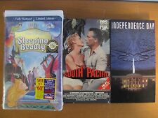 3 VHS VIDEO TAPES-WALT DISNEY'S SLEEPING BEAUTY, SOUTH PACIFIC, INDEPENDENCE DAY