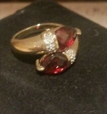 14k yellow gold Garnet bypass ring with diamond accents, size 6