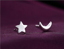 Silver tone mismatched moon and star stud earrings