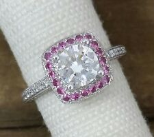 Stunning 18kt white gold with pink sapphire halo and diamond semi-mount