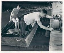 1954 Couple in Boat Demonstrate Wrong Way to Load Outboard Motor Press Photo