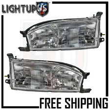 Headlights Headlamps Pair Left right set for 92-94 Toyota Camry