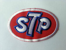 MOTORSPORTS RACING TYRE SEW ON / IRON ON PATCH:- STP (a) STP OILS RED OVAL