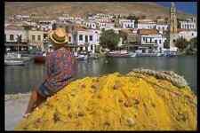 635011 Woman At Harbor Halki Greece A4 Photo Print