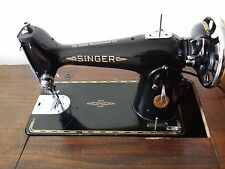 Singer 201K Heavyweight Electric Sewing Machine in dark wood cabinet