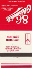 VINTAGE AUTO DEALER MATCHBOOK COVER. HERITAGE OLDS-CAD. FAIRFIELD, OH.