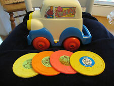 VINTAGE TOMY MUSICAL TRUCK WITH 4 DISCS VERY RARE HARD TO FIND BATTERIES INSIDE