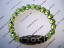 FENG SHUI - 7 EYE DZI WITH 8MM FACETED EMERALD