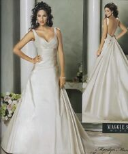 Wedding dress by Maggie Sottero. Ex-sample, Size 10, satin, Marilyn Marie!