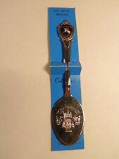 New Orleans souvenir jam - butter spoon with medallion at top of the handle