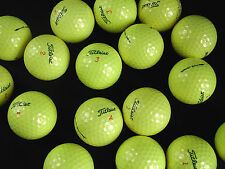 12 yellow Titleist DT Solo golf balls in premium condition
