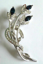 A VINTAGE 1980s FLOWER BROOCH WITH DARK BLUE & WHITE DIAMANTES
