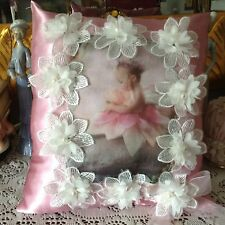 Pink satin pillow with image of baby fairy