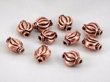 Unusual pure copper decorated pumpkin pillow  beads . 10 x 15 mm. Pack of 15.