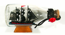 """Nice smaller pirate ship in glass bottle 4 3/4"""" x 2 3/4"""" black sails"""