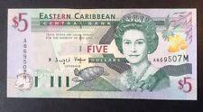 East caribbean billet. 5 dollars. universel. queens portrait