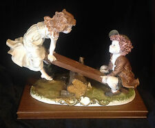 CAPODIMONTE SIGNED GIUSEPPE ARMANI PORCELAIN HAND PAINTED BOY & GIRL ON SEESAW