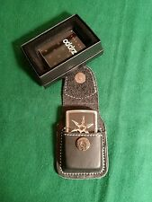 Zippo Lighter: Ninja shurikan with leather belt holder. (Collectable item ).