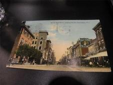 VINTAGE POSTCARD SOUTH ELM STREET LOOKING SOUTH GREENSBORO NC OLD HENRY WHISKEY