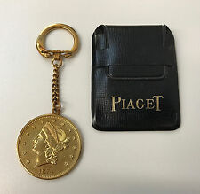 VINTAGE PIAGET KEY CHAIN Gold Metal Coin with Case New Old Stock from the 1960's