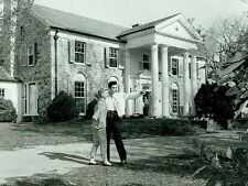 Elvis Presley -  Elvis outside Graceland right after he purchased it in 1957.