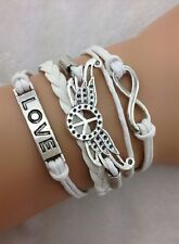 Bracelet blanc  peace and love avec ailes d'ange,  love et lien infini