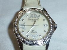 $1400 Raymond Weil Tango Swiss Watch 36 diamonds, white pearl face, broken hand