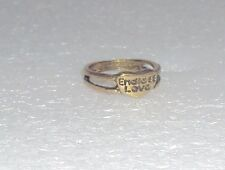 """A ring with elongated heart, it says """"Endless love"""""""