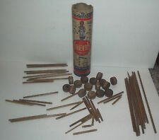 VINTAGE TINKERTOY CONTAINER WITH SOME OF THE PARTS WITH IT PATENT 1915