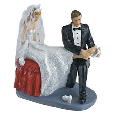 Bride an Groom putting on shoe Wedding Cake topper cake decoration