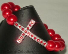 SILVER TONED SIDEWAYS JEWELLED CROSS STRETCH BRACELET with RED PEARL BEADS
