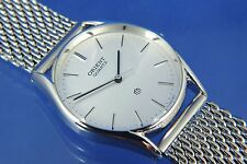VINTAGE Orient Quarzo Gents DRESS WATCH circa anni 80 NUOVO OLD STOCK nn.