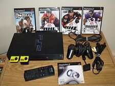 PS2 bundle w/ controller, 2 8MB memory cards, network adapter & 4 games working