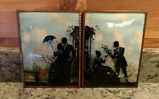 1 VINTAGE PAIR OF REVERSE PAINTED COURTING COUPLE SILHOUETTES UNDER CONVEX GLASS