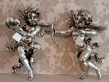 Pair of Antique Silver Shooting Cupid and Love Heart Cherub Wall Art Figures