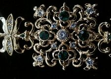 JBK gold-toned bracelet with green and white simulated crystals as accent pieces
