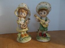 Vintage Fine Porcelain boy and girl figurines playing instruments made in Taiwan