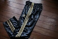 Adidas Chile 62 Tracksuit Pants. Shiny Black with Gold adidas 3stripes. size M/L