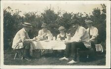 Group young men picnic table outdoors caps   (QR.1504)