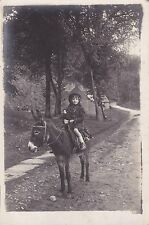 Vintage RP Postcard - Pretty Little Girl Holding Porcelain Doll, Riding Donkey