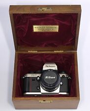 Nikon F3  HP Titanium special serie. nr 8200099 with matching lens.