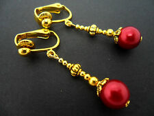 A PAIR GOLD PLATED DANGLY DARK RED GLASS PEARL CLIP ON  EARRINGS. NEW.