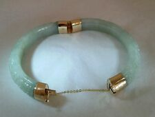 A Chinese 14ct Yellow Gold & carved green Jade bangle