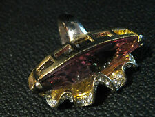 Gorgeous large gold tone metal ring with large oval purple stone