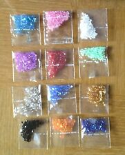 Lot of 36 (3 x 12) packets of colors of small tube beads