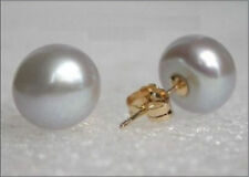 A pair of natural 10-11mm south seas gray pearl earrings 14K Gold